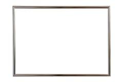 Cadre en bois argenté de photo d'isolement sur le blanc Enregistré avec la coupure Photographie stock
