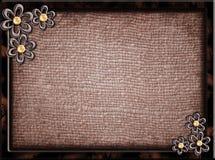 Cadre en bois avec des fleurs en métal Photos stock