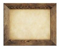 Cadre en bois avec le vieux papier d'isolement sur le blanc Images stock