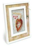 Cadre en bois décoratif de photo avec des coeurs Photos stock