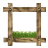 Cadre en bois de Brown sur un fond blanc avec l'espace d'herbe et de copie au centre Image libre de droits