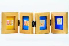 Cadre en bois de photo pour 4 photos Photos stock