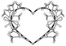 Cadre en forme de coeur et gui Photographie stock libre de droits