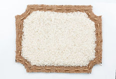 Cadre figure de toile de jute avec du riz Images libres de droits