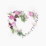Cadre floral de coeur sur le fond blanc Photographie stock