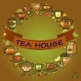 Cadre rond avec la tasse, la feuille, le citron, la théière et le ruban brun Photos stock