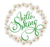 Cadre rond des fleurs blanches d'isolement le fond et le ressort des textes bonjour Lettrage de calligraphie Photo libre de droits