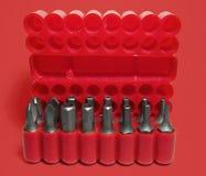 Cadre rouge avec des bits de tournevis Image stock