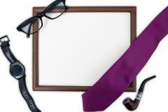 Cadre vide avec des accessoires pour le père images libres de droits