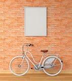 Cadre vide de photo pour la maquette sur le mur et la bicyclette, rendu 3D Image libre de droits