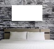 Cadre vide sur le mur en pierre dans la chambre à coucher Images stock