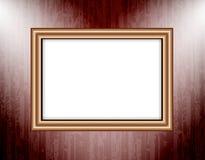 Cadre vide sur les projecteurs colorés d'un éclairage de mur Photos stock