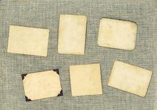 Cadres de photo de vintage au-dessus de fond de textile Papier âgé Photo stock