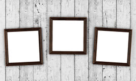 Cadres de photo sur le fond en bois Photos stock