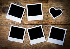 Cadres instantanés de photo, avec un en forme de coeur Images libres de droits