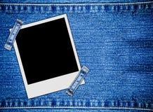 Cadres instantanés vides de photo sur des jeans images libres de droits