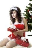 Cadres se déployants de fille de Santa avec des cadeaux Images stock