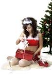 Cadres se déployants de fille de Santa avec des cadeaux Photos stock