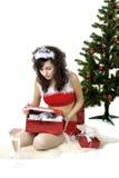 Cadres se déployants de fille de Santa avec des cadeaux Images libres de droits