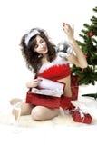 Cadres se déployants de fille de Santa avec des cadeaux Photo libre de droits