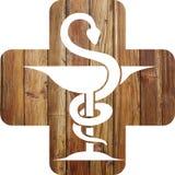 Caduceo de la cruz y de la farmacia imagen de archivo libre de regalías