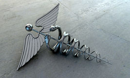 Caduceus. On glossy concrete floor royalty free stock photography