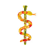 Caduceus of fruits and vegetables. Aesculapius staff of a lot of fruits and vegetables royalty free stock photos