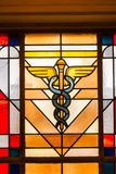 Caduceus medicine Symbol stained Glass window. Caduceus medicine snake Symbol stained Glass window in the city hall of Esch sur Alzette Luxembourg royalty free stock image