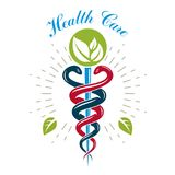 Caduceus symbol, healthcare conceptual vector logo. Homeopathy c. Reative emblem Royalty Free Stock Photo