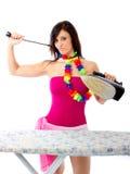 Caduta disperata della casalinga con ferro fotografia stock libera da diritti