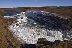 Cadute dorate coperte di ghiaccio, cascata di Gullfoss, Islanda. Immagini Stock Libere da Diritti