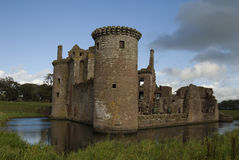 Caerlaverock Castle, Dumfries and Galloway. View from the west of the ruin of Caerlaverock Castle, a medieval stronghold of lowland Scotland. The moat of the Royalty Free Stock Photo