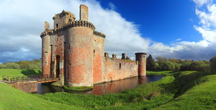 Caerlaverock Castle, Dumfries & Galloway, Scotland. Caerlaverock Castle, located near the Solway Firth in Southern Scotland near Dumfries, is surrounded by a Royalty Free Stock Photos