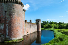 Caerlaverock Castle, Scotland. Triangular shaped castle with water filled moat originally built in 13th century Royalty Free Stock Image