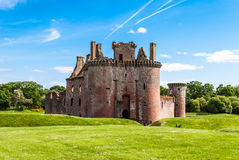 Caerlaverock Castle, Scotland. Triangular shaped castle with water filled moat originally built in 13th century Royalty Free Stock Images