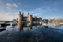 Caernarfon Castle. At high tide with the boats floating in the water North wales Stock Photography