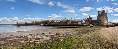 Caernarfon Castle. And town as seen from the beach Royalty Free Stock Images