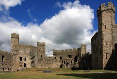 Caernarfon castle. And battlements along the River Seiont in North Wales Stock Photos