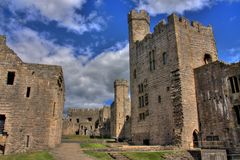 Caernarfon castle. And battlements along the River Seiont in North Wales Stock Image