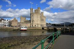 Caernarfon castle. And battlements along the River Seiont in North Wales Royalty Free Stock Images