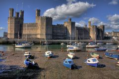 Caernarfon castle. And battlements along the River Seiont in North Wales Stock Photography