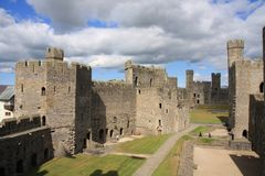 Caernarfon castle. And battlements along the River Seiont in North Wales Royalty Free Stock Photos