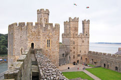 Caernarfon castle battlements. On the battlements of Caernarfon Castle, Wales, overlooking the towers towards the coast Stock Images