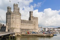 Caernarfon Castle Wales. Caernarfon Castle built in 1283 by Edward the First of England after his invasion of Wales. It is now classified as a world heritage Stock Photos