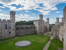 Caernarfon Castle, North Wales. CAERNARFON, WALES - 29 SEPTEMBER 2013: View on the inner courtyard at Caernarfon Castle, well-known for its polygonal towers Stock Images