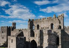 Caernarfon Castle, North Wales. Caernarfon Castle, well-known for its polygonal towers, dates from the 13th century.  In 1969 Prince Charles was invested here as Stock Photos