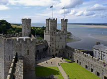 Caernarfon Castle, Wales, United Kingdom. Caernarfon is architecturally one of the most impressive of all of the castles in Wales. Caernarfon is located at the stock photography