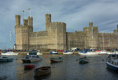 Caernarfon Castle. Wales. View across the River Seiont toward Caernarfon Castle  which is a medieval fortress in Caernarfon, Gwynedd, north-west Wales cared for Stock Image