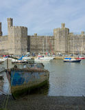 Caernarfon Castle. Wales. View across the River Seiont toward Caernarfon Castle  which is a medieval fortress in Caernarfon, Gwynedd, north-west Wales cared for Stock Photos