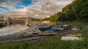 Caernarfon, Gwynedd, Wales, UK. June 15, 2017: Evening sun over boats at the shore of Afon Seiont Royalty Free Stock Images